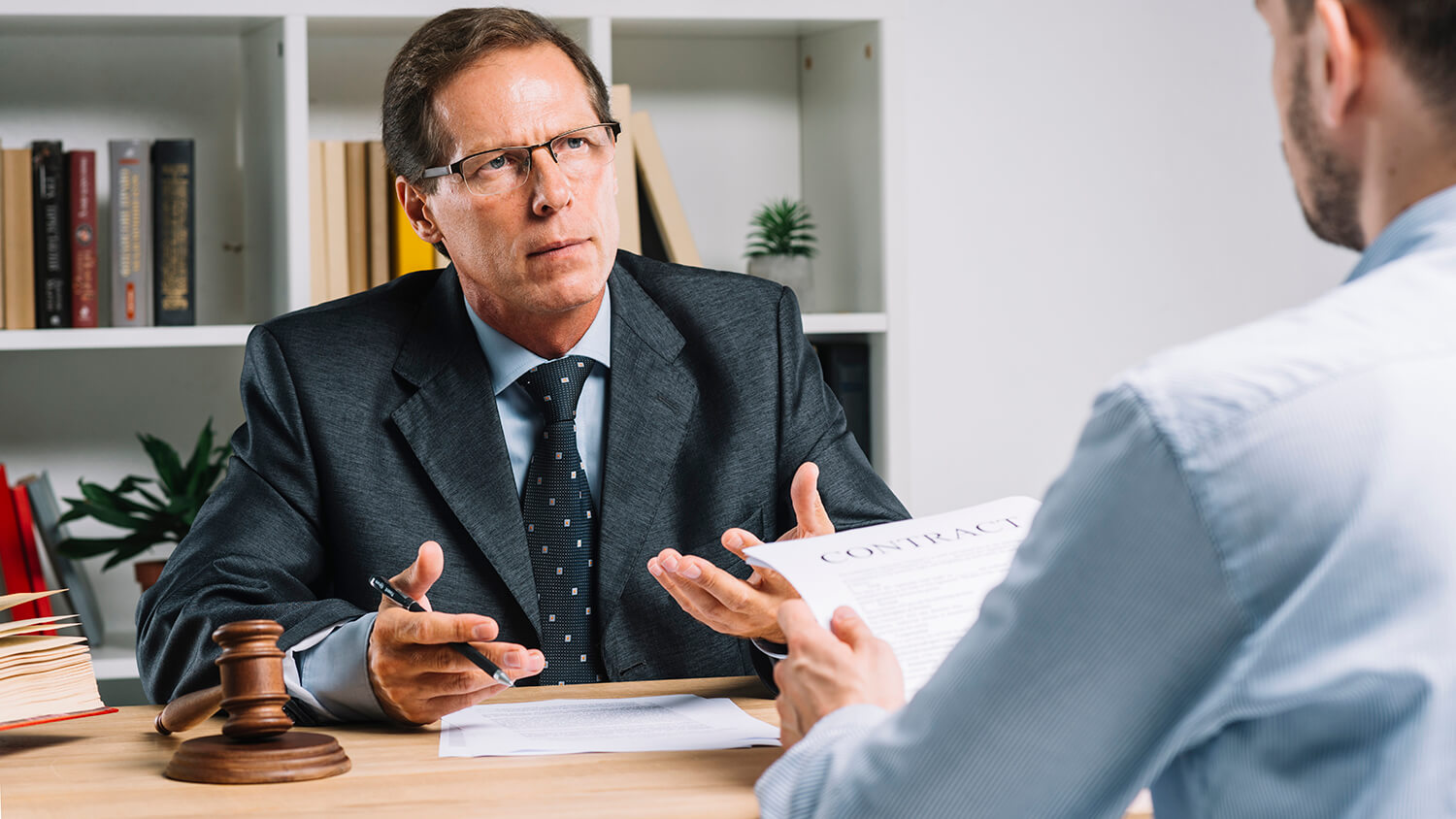lawyer discussing contract with client