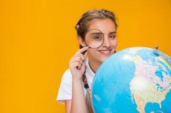 schoolgirl with globe