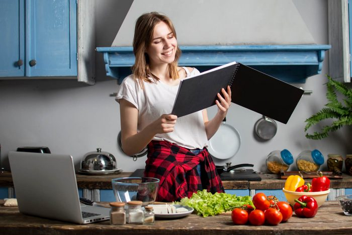 student prepares vegetarian salad